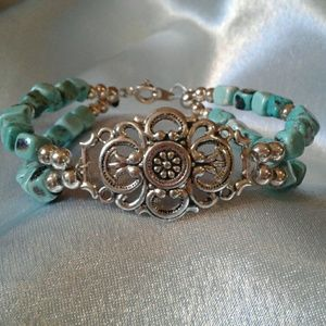 Double stranded turquoise bracelet.